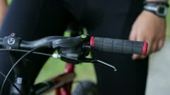 Close up of a man's hand holding handlebar on a bike Stock Footage