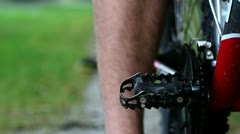 Close up of a boy's leg cycling Stock Footage