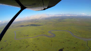 Stock Video Footage of Aerial view of winding rivers  swampland Alaskan Wilderness light aircraft,