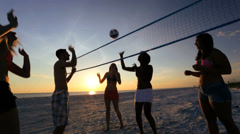 College Friends Laughing Enjoying Sunset Beach Volleyball Stock Footage