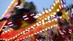 Funfair oktoberfest carousel close 11056 Stock Footage