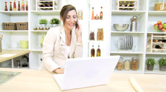 Stock Video Footage of Smart Businesswoman Kitchen Counter Using Wireless Technology