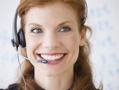 Stock Photo of Cheerful businesswoman wearing headset