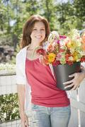 USA, New York, Flanders, Portrait of woman with bunch of flowers Stock Photos