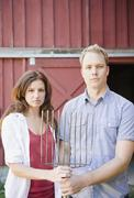 USA, New York, Flanders, Portrait of mid adult couple with pitchfork Stock Photos
