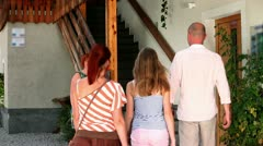 Family meeting a host on a cheese farm Stock Footage