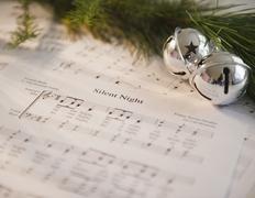 Christmas baubles on carol music sheet Stock Photos