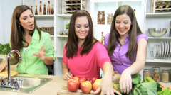 Teenage Girls Mother Kitchen Fresh Fruit Vegetables Stock Footage