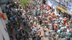 Tilt down top shot overlooking the Pride Parade Stock Footage