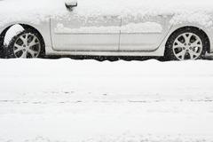 USA, New York State, Brooklyn, Williamsburg, car on street during blizzard - stock photo