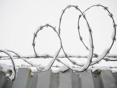 USA, New York State, Brooklyn, Williamsburg, barbed wire covered with snow - stock photo