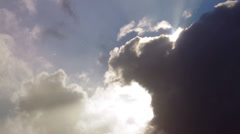Sun emerges from behind cloud Stock Footage