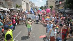 Static shot infront of the crowd participating in Pride Parade Stock Footage