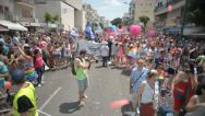 Stock Video Footage of static shot infront of the crowd participating in Pride Parade