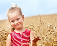 Kid in wheat field. Stock Photos