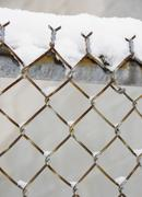 USA, New York State, Brooklyn, Williamsburg, snow covered chainlink fence Stock Photos