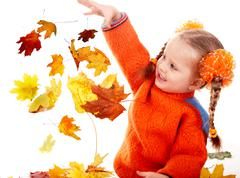Girl child in autumn orange leaves. fall sale. Stock Photos