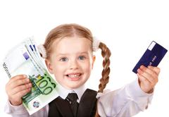 Stock Photo of happy child with money and credut card.