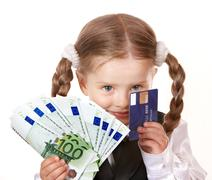Child holding money and credit card. Stock Photos