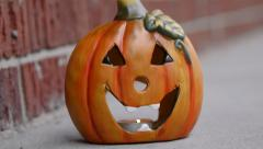 Zooming Halloween Pumpkin On Porch Evening - Home Decoration Stock Footage