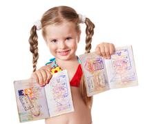 Stock Photo of child holding international passport.