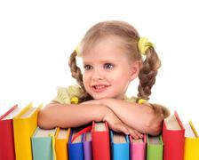 Stock Photo of child holding pile of books.
