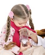 Stock Photo of sick child take  medicine. isolated.