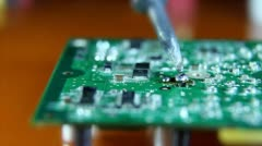 Shot of a man solder a  chip on a graphics card Stock Footage