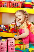 Stock Photo of child  playing with building block .