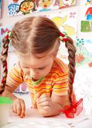 child with chalk draw in playroom. - stock photo