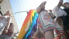 Low angle shot of people gather at Pride Parade in Tel-Aviv Stock Footage