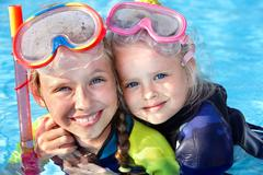 Children in swimming pool learning snorkeling. Stock Photos