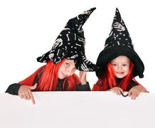 child  witch holding banner and thumb up. - stock photo
