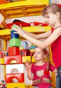 child plaing block and construction set in preschool. - stock photo