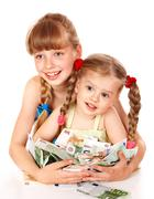 children holding pile of money. - stock photo