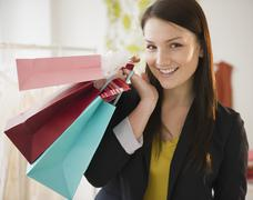 Stock Photo of Young woman holding shopping bags