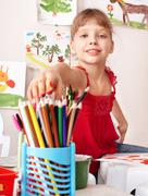 child drawing colour pencil in preschool. - stock photo