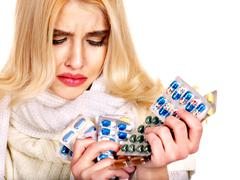 Woman having pills and tablets. Stock Photos