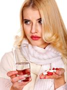 young woman having flu takes pills. - stock photo