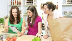 Teenage Girls Mother Kitchen Tablet Fresh Fruit Vegetables Stock Footage
