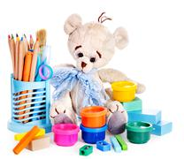 cans of paint and teddy bear. - stock photo