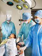 woman on gurney in operating room. - stock photo