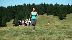 Young woman runnning on a tableland with special climate Stock Footage