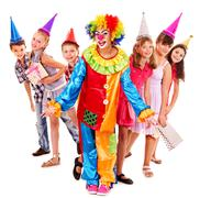 Stock Photo of birthday party group of teen with clown.