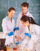 group chemistry student with flask. - stock photo