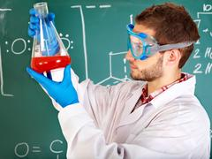 man chemistry student with flask. - stock photo