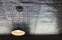 Pendant lamp on tiled ceiling Stock Photos