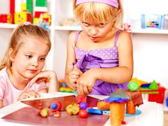 child playing plasticine. - stock photo