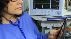 Hospital Worker Uses Tablet Computer Stock Footage