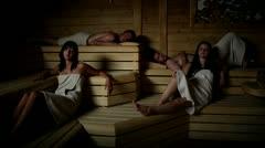 Two couple enjoying in sauna - stock footage